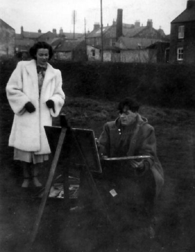 Tom painting, Dorothy having a look. Possibly in Cumnock